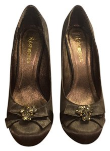 Restricted gold champagne Pumps