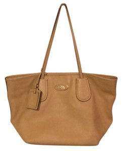 Coach Tote in caramel, beige, tan with gold accent