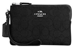 Coach Wristlet in Silver/Black/Black