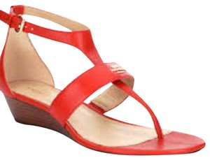 Coach coral red Wedges