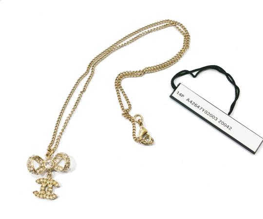 Chanel Authentic Chanel Light Gold Ribbon Bow CC Dangle Necklace