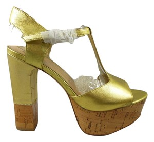 Dolce Vita Gold Platforms