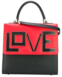 Les Petite Joueurs Satchel in black and white and red