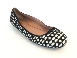 ALAÏA Black / White Flats