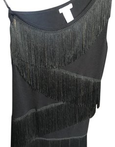 Cache Top Black with black and gold fringe!
