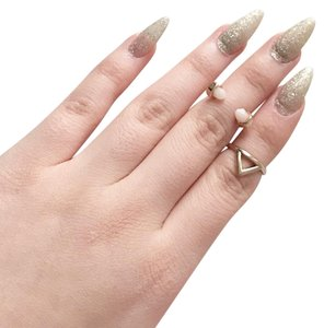 Urban Outfitters gold crystal triangle midi rings