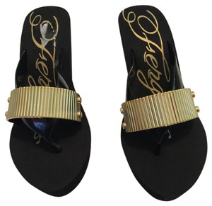 Fergie black and gold Sandals