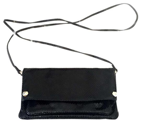 Preload https://img-static.tradesy.com/item/20606335/henri-bendel-convertible-flap-clutch-black-leather-cross-body-bag-0-1-540-540.jpg