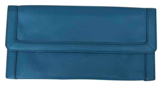 Preload https://img-static.tradesy.com/item/20606921/banana-republic-teal-leather-exterior-fabric-interior-clutch-0-1-540-540.jpg