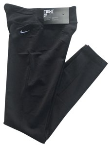 Nike Women's Nike Legend Tight Fit Training Tights Material: 87% nylon, 13% spandex Style/Color: 669744-010