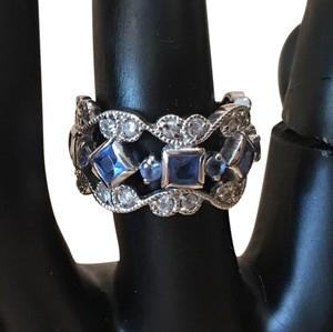 sterling and blue topaz ring Size 6 sterling silver and blue topaz ornate ring.