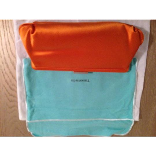 Tiffany & Co. orange Clutch