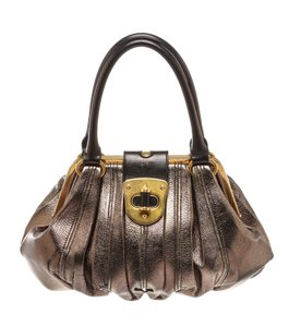 Alexander McQueen Satchel in Black/Metallic Gold