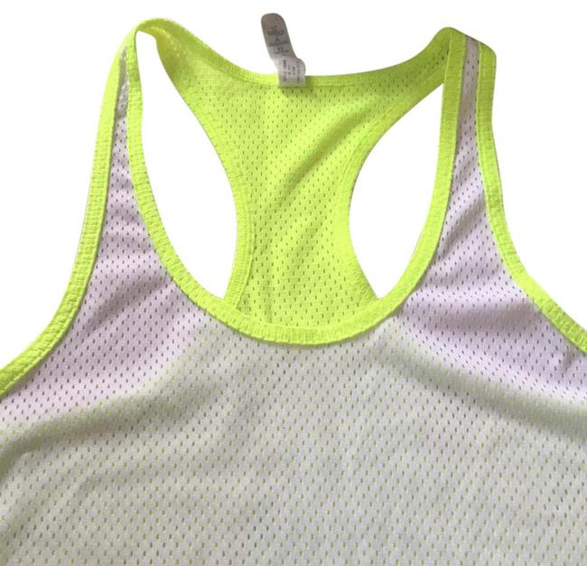 Preload https://item4.tradesy.com/images/under-armour-white-with-florecen-yellow-heat-gear-activewear-top-size-8-m-20619333-0-1.jpg?width=400&height=650