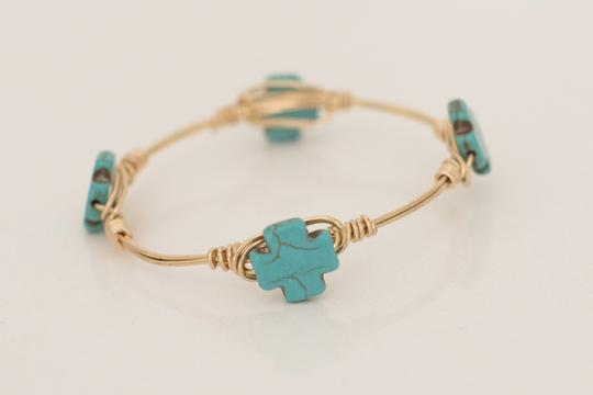 Preload https://item1.tradesy.com/images/gold-and-turquoise-cross-bangle-bracelet-20620900-0-0.jpg?width=440&height=440