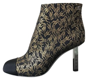 Chanel black gold Boots