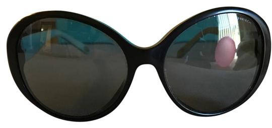 Preload https://item2.tradesy.com/images/tiffany-and-co-black-blue-sunglasses-20621771-0-1.jpg?width=440&height=440