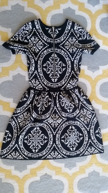 Romeo & Juliet Couture short dress Black & White Sweater A-line Mid-thigh on Tradesy