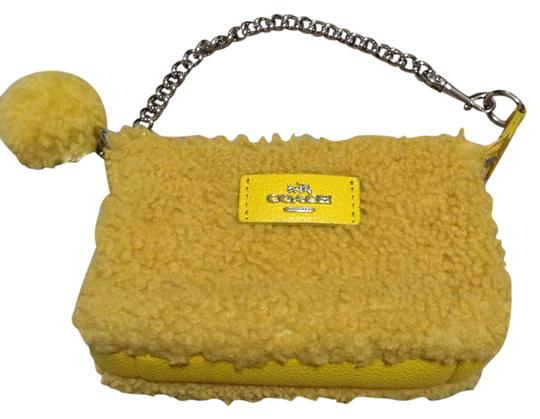 Preload https://img-static.tradesy.com/item/20622454/coach-shearling-yellow-wristlet-0-1-540-540.jpg