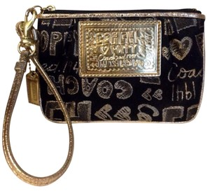 Coach Wristlet in Black Gold