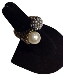 Other bronze/black, pearl pinky ring