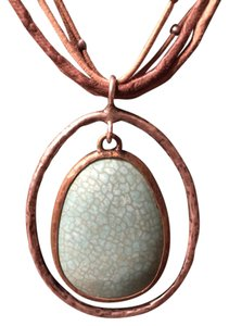 Silpada Turquoise Oval Pendant on multi-strand leather necklace