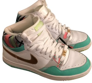 Nike Metallic Gold Swoosh. White Base With Turquoise elements. Fun pink, black, lime green art highlights Athletic