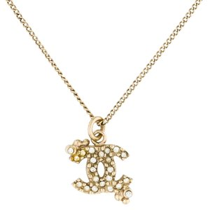 Chanel Gold-tone Chanel interlocking CC fcrystal pendant necklace