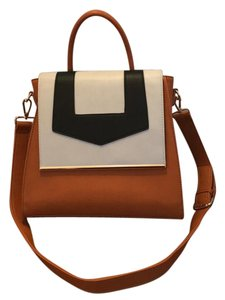 Lionel Satchel in Caramel, cream, and black with gold metal detailing