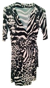 Glam short dress Black and white Stretchy V-neck Polyester Two-tone Animal Print on Tradesy