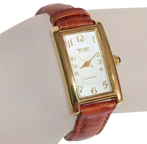 Gruen Gruen curvex classic gold tone brass swiss made croc leather women's watch onyx
