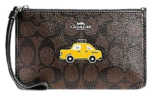 Coach Taxi Wristlet in Brown / Black