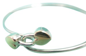 Tiffany & Co. Tiffany and co intertwined hearts bangle in 18kt and .925
