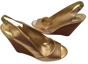 Jessica Simpson Gold Wedges