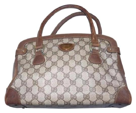 Preload https://img-static.tradesy.com/item/20645842/gucci-vintage-style-purse-brown-large-g-logo-coated-canvas-and-brown-leather-leathercoated-satchel-0-0-540-540.jpg