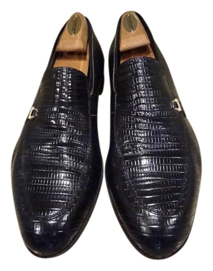 Preload https://img-static.tradesy.com/item/20646444/florsheim-black-man-lizard-loafers-slip-on-vintage-formal-shoes-size-us-95-regular-m-b-0-1-540-540.jpg