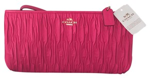 Coach Wristlet in Pink / Gold