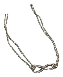 Tiffany & Co. infinity pendant with double chain