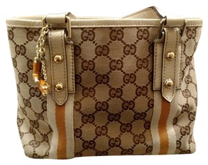 Gucci Satchel in Beige GG Canvas and leather with dark yellow detail.