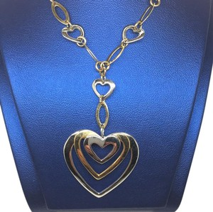 14 karat yellow and white gold triple heart necklace