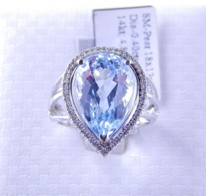 Aqua NATURAL PEAR SHAPE AQUAMARINE WITH HALO OF DIAMONDS