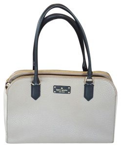 Kate Spade Satchel in champagne, black, and ivory with bow tie interior