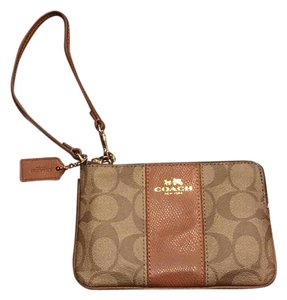 Coach Wristlet in brown with chestnut stripe