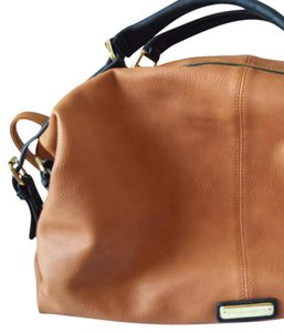 Steve Madden Satchel in Brown and Black with Gold hardware.