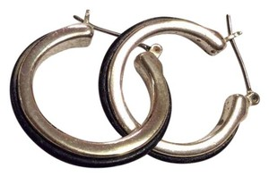 Premier Designs Loop earrings. Silver with a small black leather trim.