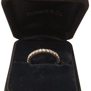 Tiffany & Co. shared setting diamond full circle band ring