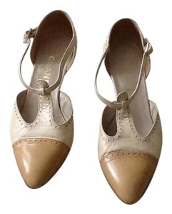 Chanel Classic cream and tan pumps Pumps
