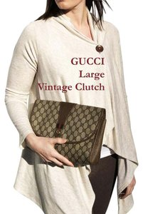 Gucci Dust Accessory Collection tan Clutch