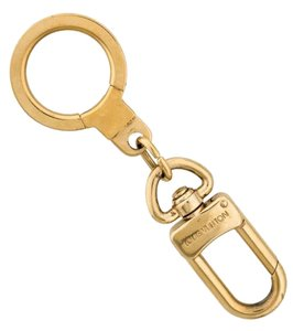 Louis Vuitton Brass gold-tone Louis Vuitton LV logo Bolt Key Extender