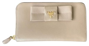Prada saffiano bow zip around wallet